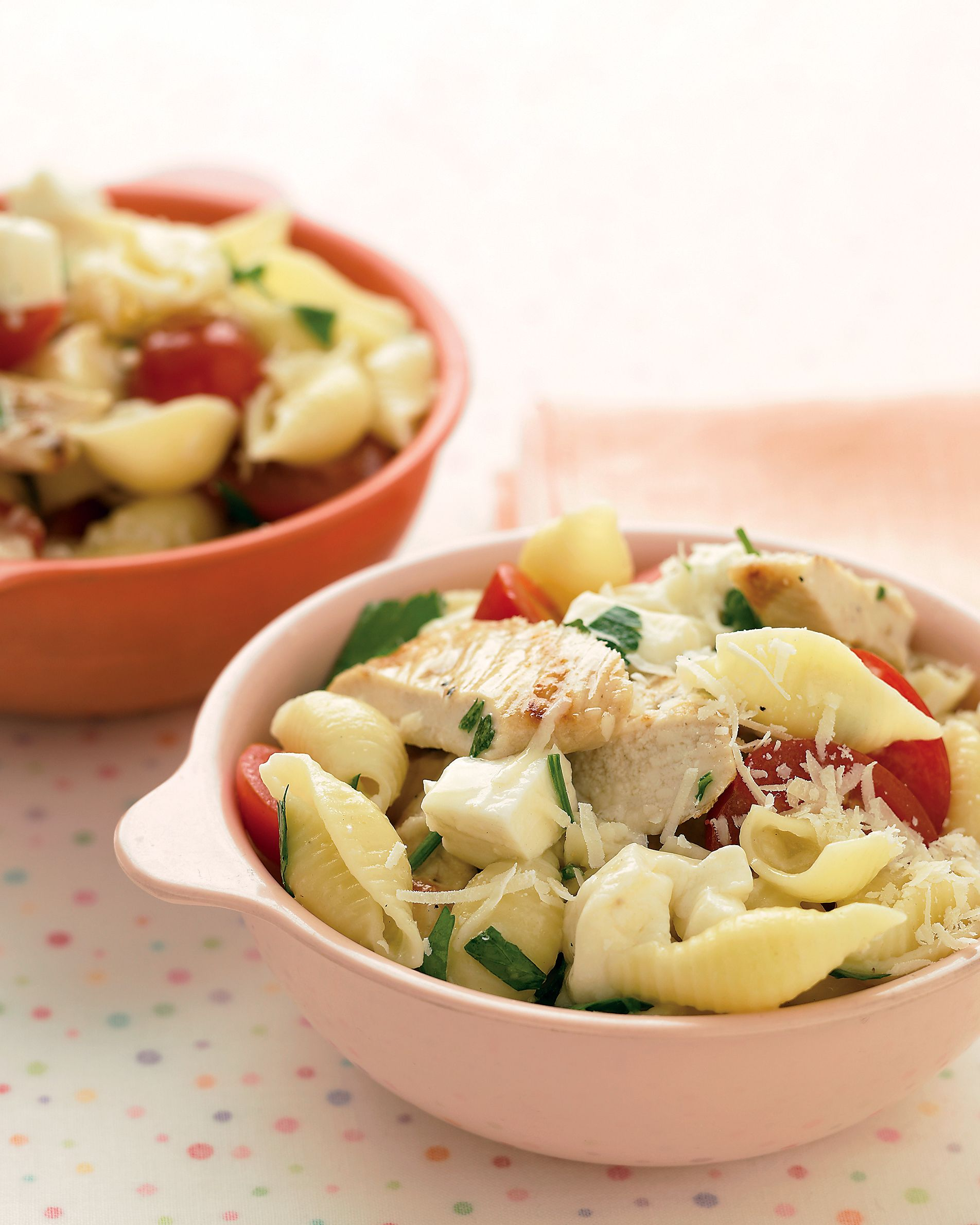 Bowls of Caprese-style chicken pasta -- with tomatoes, cheese, and herbs -- answer the question of what to have for dinner tonight. You need only 30 minutes, start to finish.