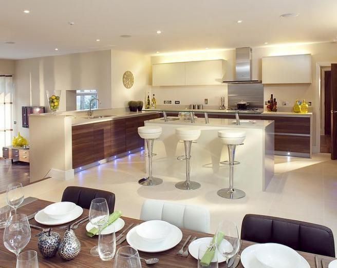 Photo Of Contemporary Open Plan Beige White Dining Area Room Kitchen Lounge With Lighting And Stools