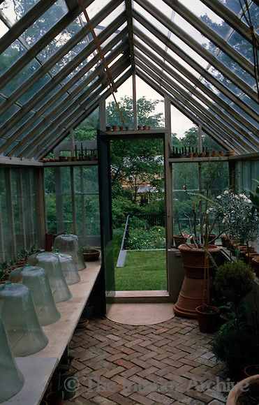 Inside, this greenhouse waits for its winter treasures   A garden ...