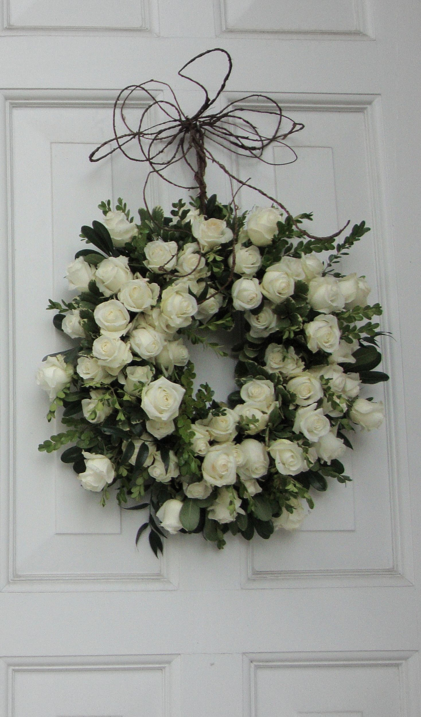 White rose wreath for church doors or as a centerpiece