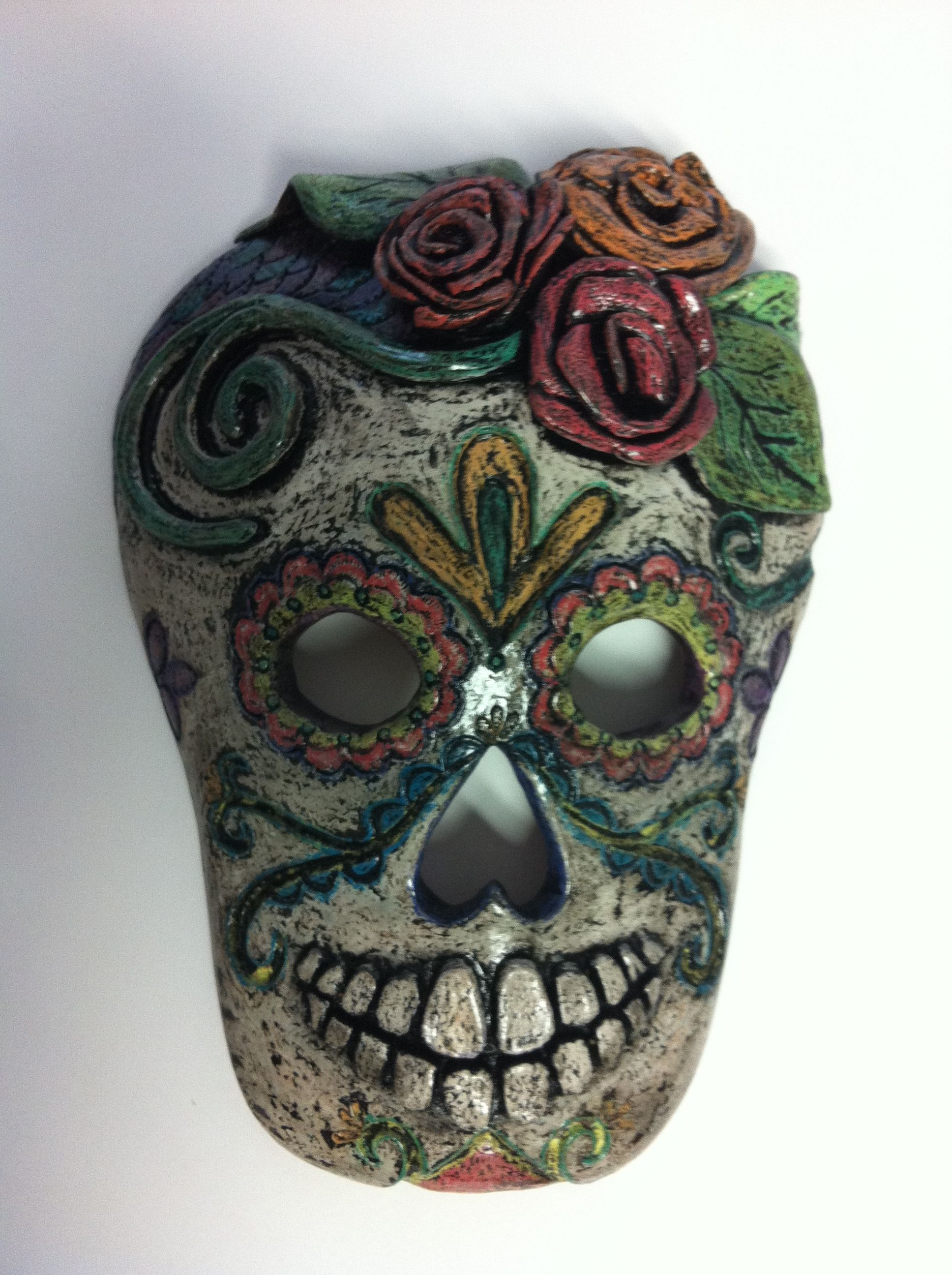 my day of the dead ceramic mask decorated with crayon, ink, and
