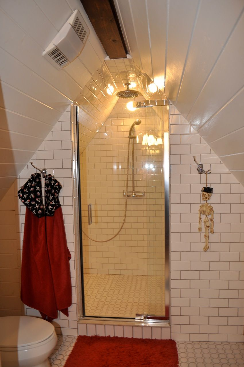 Subway tiled attic bathroom great use in angled room for for Great bathrooms in small spaces