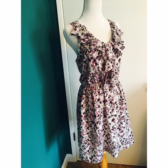 BCBGeneration floral print dress Flows dress with ruffled neckline. Elastic around waist. Fabric is silky almost chiffon-like and there's a thin liner. BCBGeneration Dresses Midi