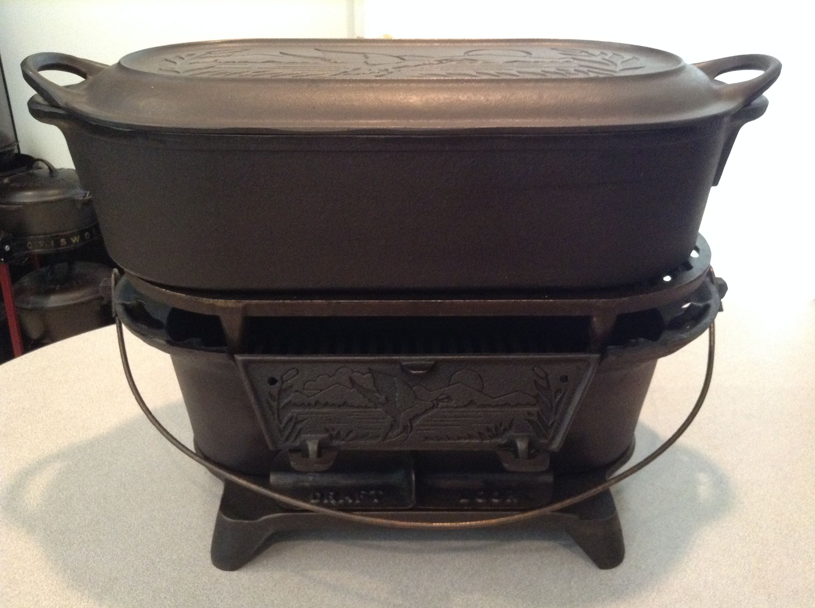 Lodge duck scene sportsman cooker with griddle lid for Cast iron fish fryer