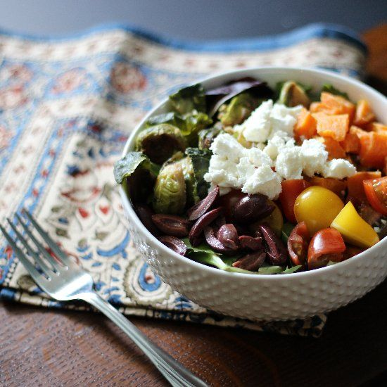 Brighten up your day with this colorful Greek salad with roasted Brussels sprouts, butternut squash, olives, and feta.