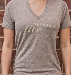 Girl's V-Neck Eco Brown - Cultivation Five is a T-shirt line that joins style, comfort and class with giving back to the community.  Partnering with children's charities, the company donates $5 to the charity chosen by you, the consumer, with each T-shirt sold.  With your purchase, you will also be provided with a handmade drawstring bag.  #C5 #CharityFashion #GiveBack