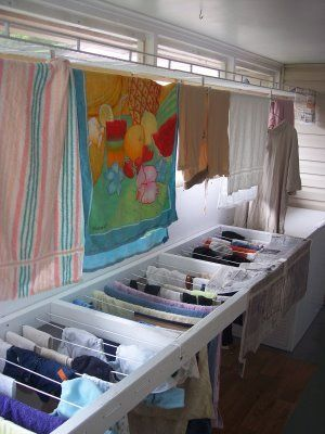 Custom indoor drying rack - blog post about an indoor laundry drying area  built on an enclosed back porch. Photos and details are enough for someone  to ...
