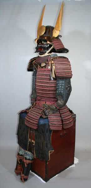 Hon kozane Murasaki ito ni mai dou gusoku. Kujira wakidate no nagaboshi kabuto. Early Edo: Genna period‑ Early 1600. Purple laced true kozane two piece dou armor and long standing rivet kabuto with whale baleen wakidate, completely matching, kabuto has large standing rivets similar to an igabachi kabuto (kabuto with long spike rivets) and whale baleen wakidate (side helmet crests), early and correct double tomoe (comma shaped pattern) mon, ubu (unchanged, original cond.