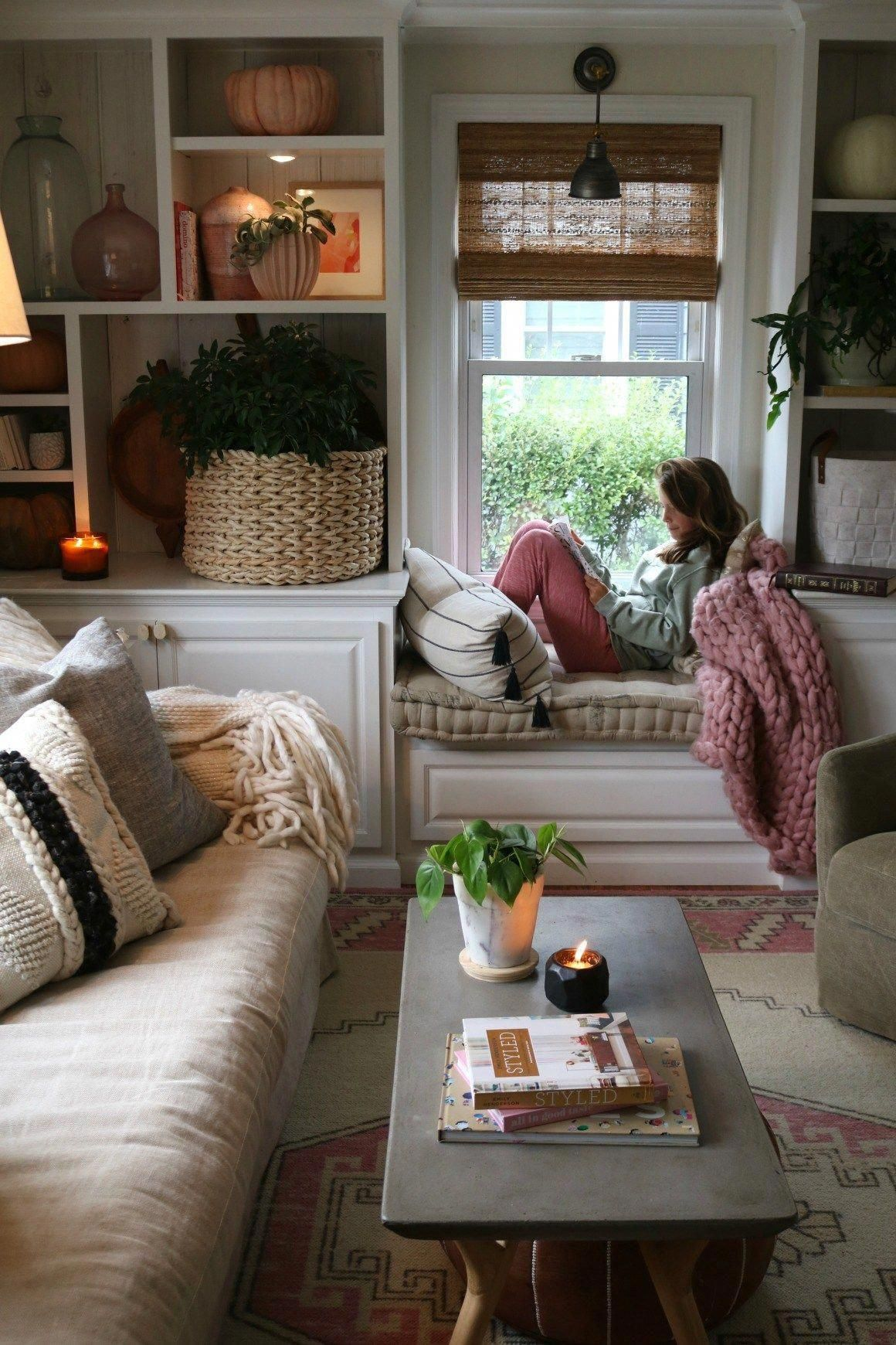 Easy fall decorating ideas in the living room, especially tips for styling your shelves with house plants, candles, pumpkins, and a gorgeous autumn colors! #nestingwithgrace #fallhome #homeaccessories #homeInterior #LivingRoomWallDecor