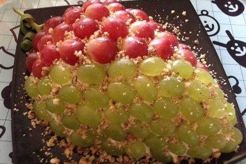 Layered salad Tiffany with grapes