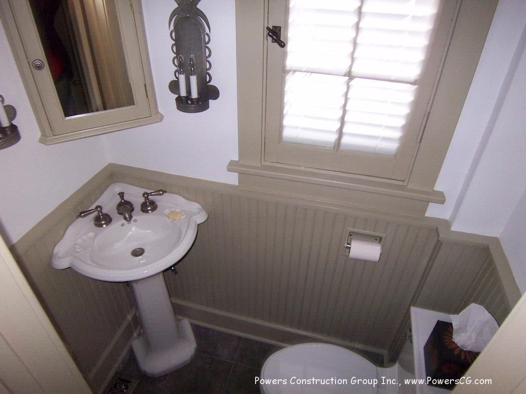 Bathroom with pedestal sink ideas - Small Powder Room With Pedestal Sink In The Corner And Beadboard Walls