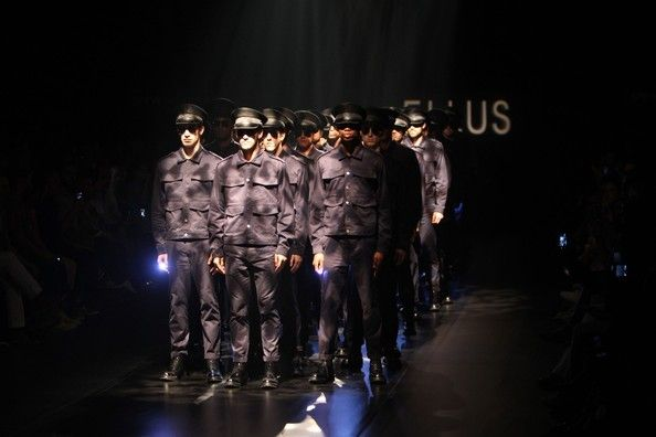 Models show off military themes on the catwalk at the Ellus show during Sao Paulo Fashion Week in Brazil