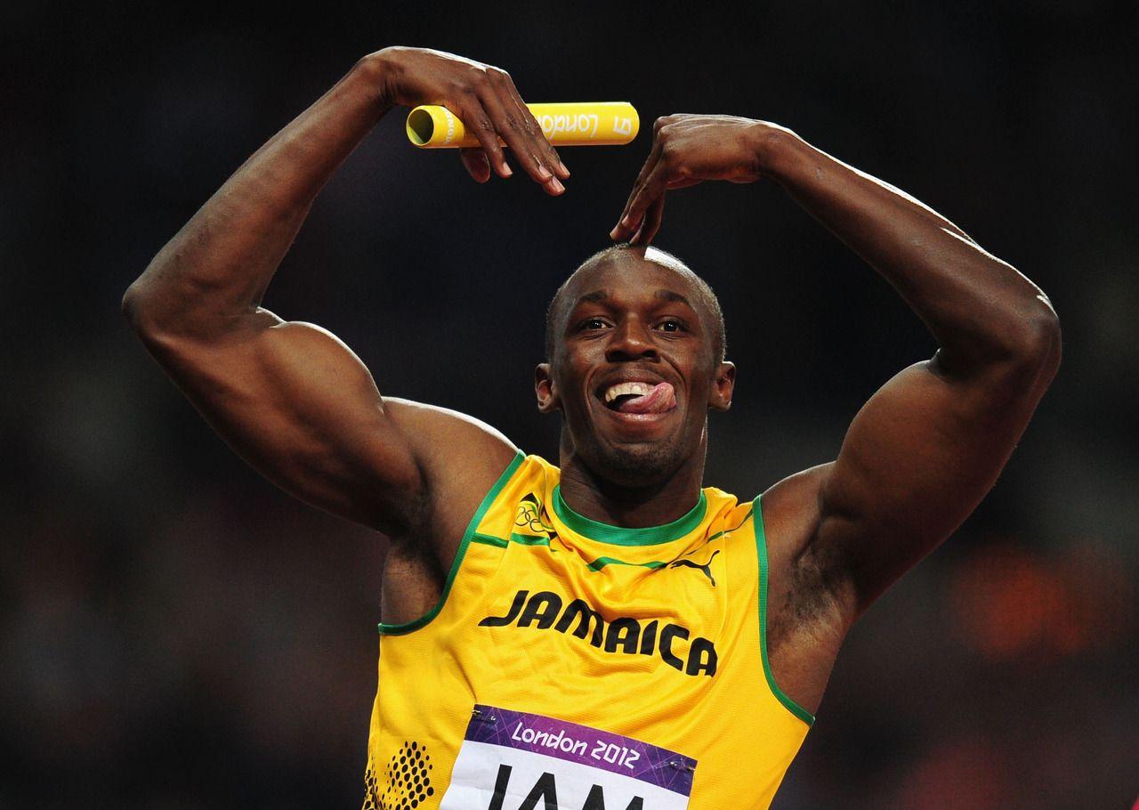 Usain Bolt of Jamaica celebrates winning gold and setting ...