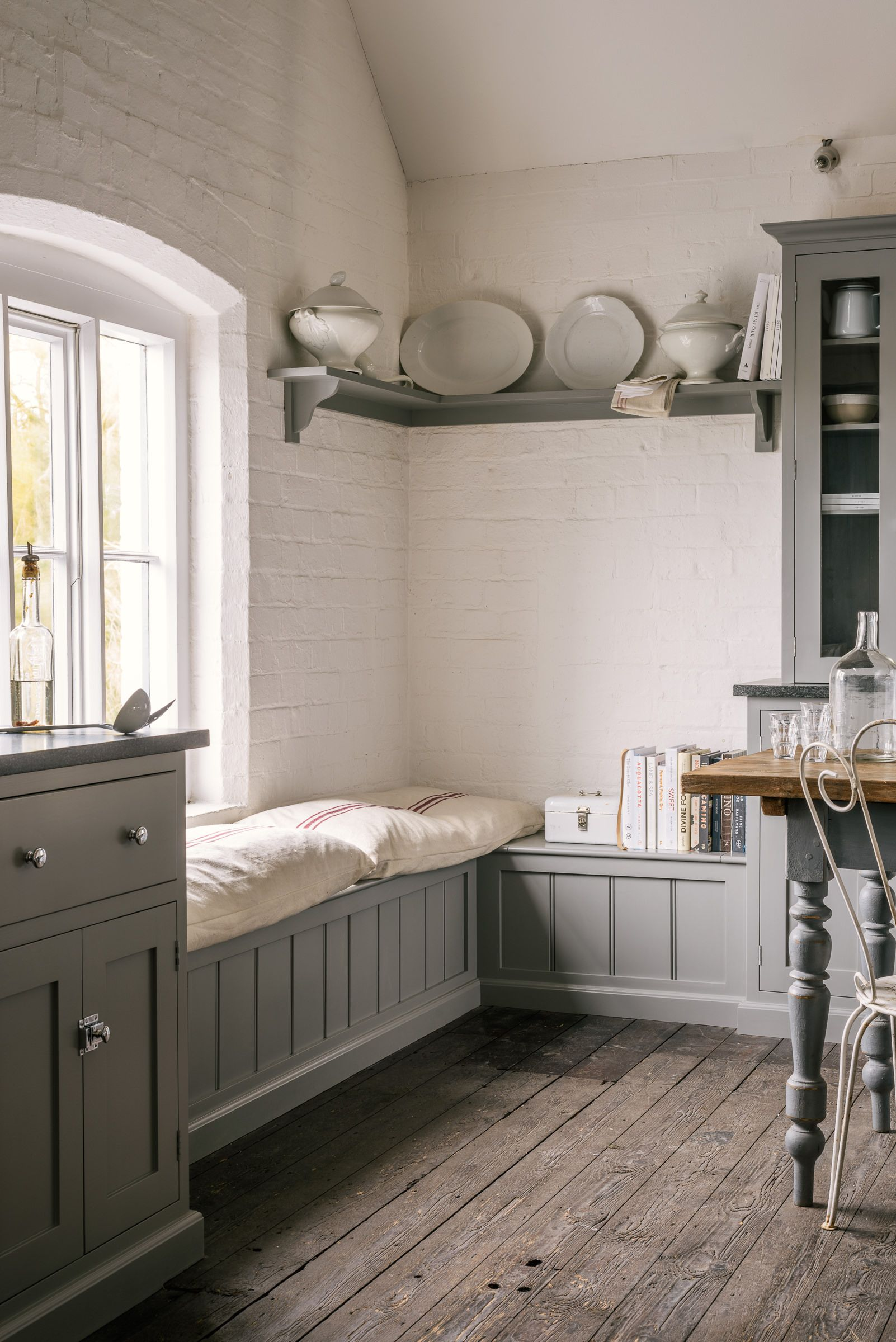 The perfect shaker window seat painted in soft grey with big squidgy
