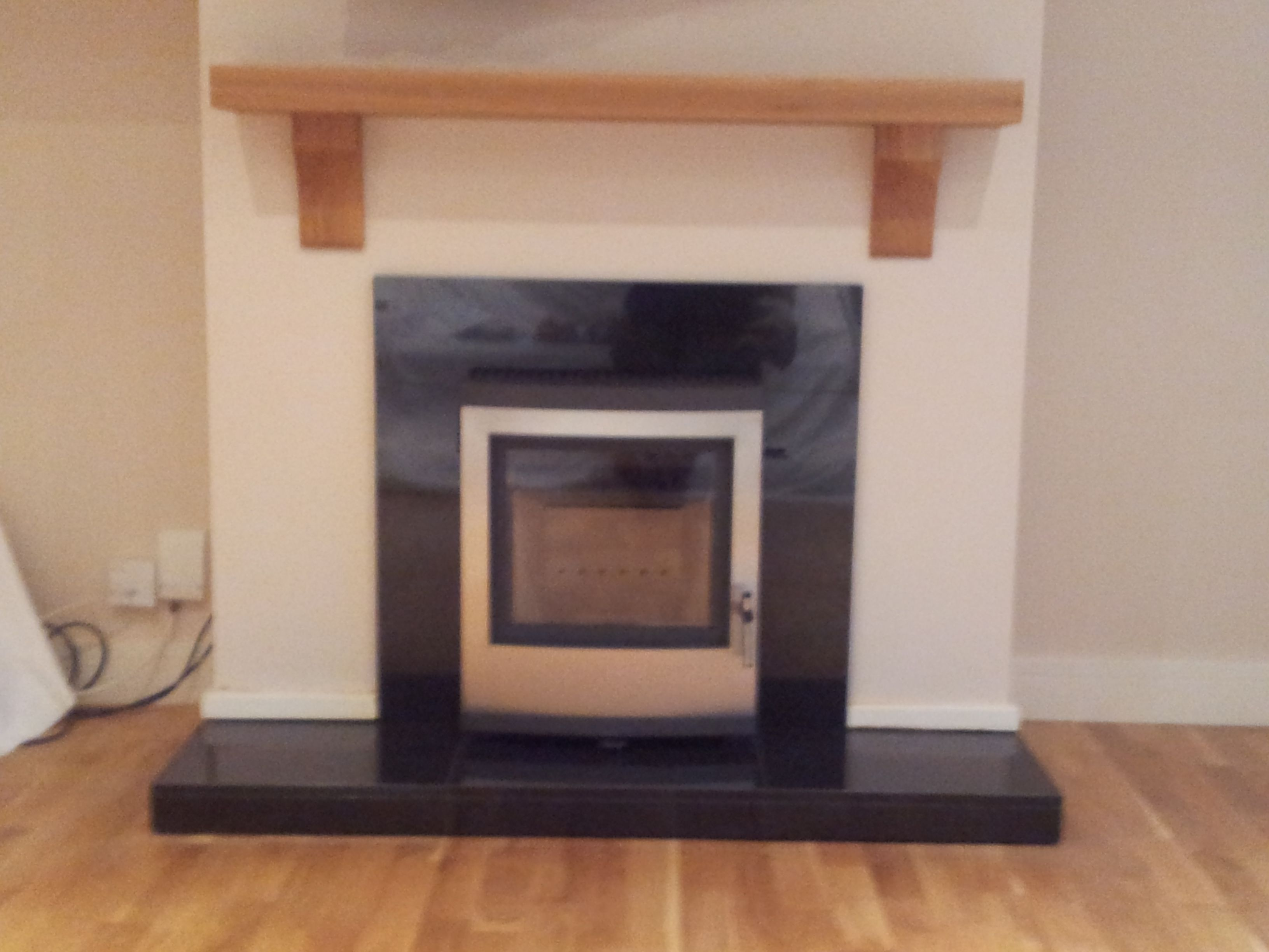 Esse Inset Wood Burning Stove With Granite Slips And Hearth Shown With Oak Beam Corbels Chiswell Fireplaces Fireplace Wood Burning Stove Stove Fireplace