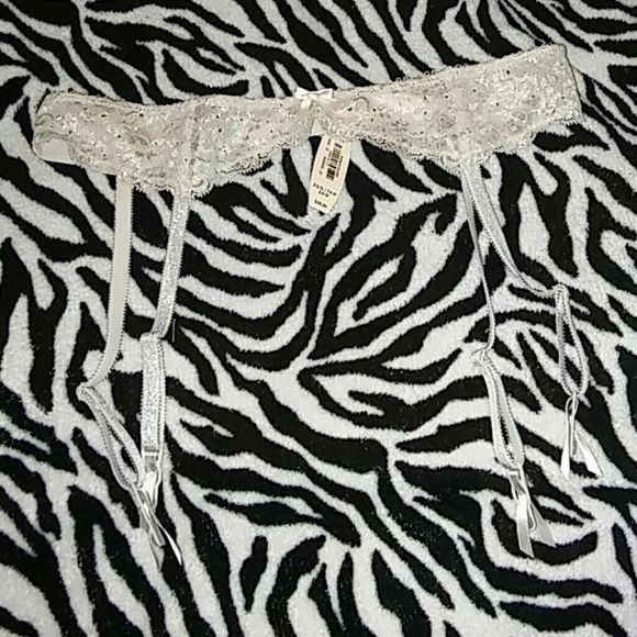 Victoria's secret garter rhinestone belt xs/s new Vs brand New Xs/s Marker mark on size tag Rhinestones Adjustable back hook Adjustable garter strap Cream/beige Silver hints Trade value 12 Victoria's Secret Intimates & Sleepwear