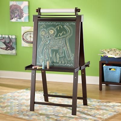 Easel Does It- we have this and it works great and is good looking.  Dry erase on the other side with paper you can pull down from the top roll for painting