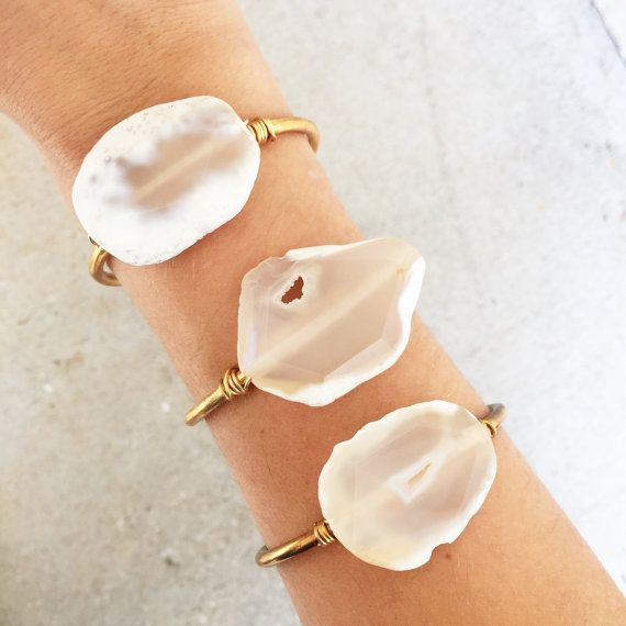 Beautiful one of a kind white agate slice securely wire wrapped onto a solid brass adjustable cuff. Note: all stones will vary slightly in appearance. Cuff is adjustable for best fit!  Your purchase will come neatly packaged in a Gypset branded linen bag ready to be given as a gift or kept for yourself xx   >>>>>>>>____>>>>>>>>>  We believe in originality and not conforming to the masses. Each piece we sell is unique and one of a kind. Keepin...