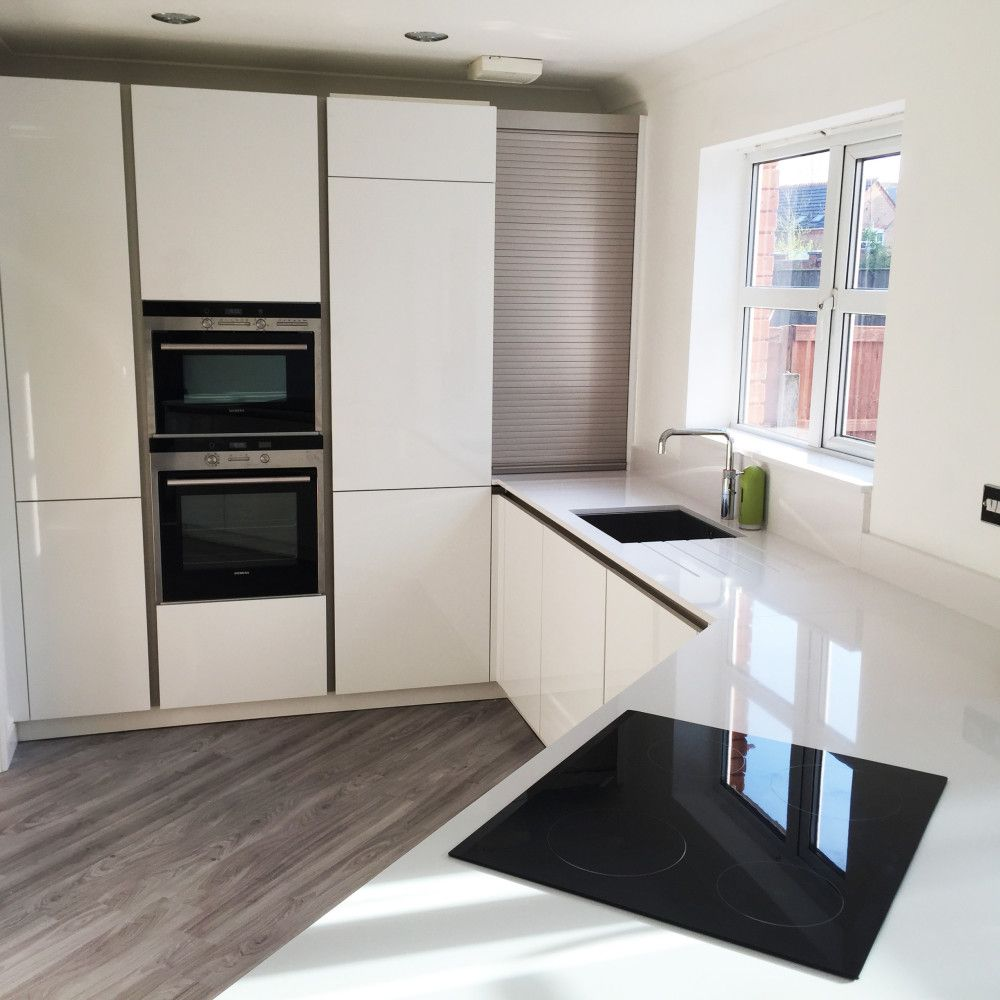 white gloss german schuller kitchen with white silestone work