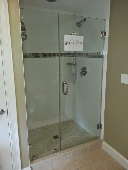 Swinging Frameless Shower Door That Closes Against A Stationary