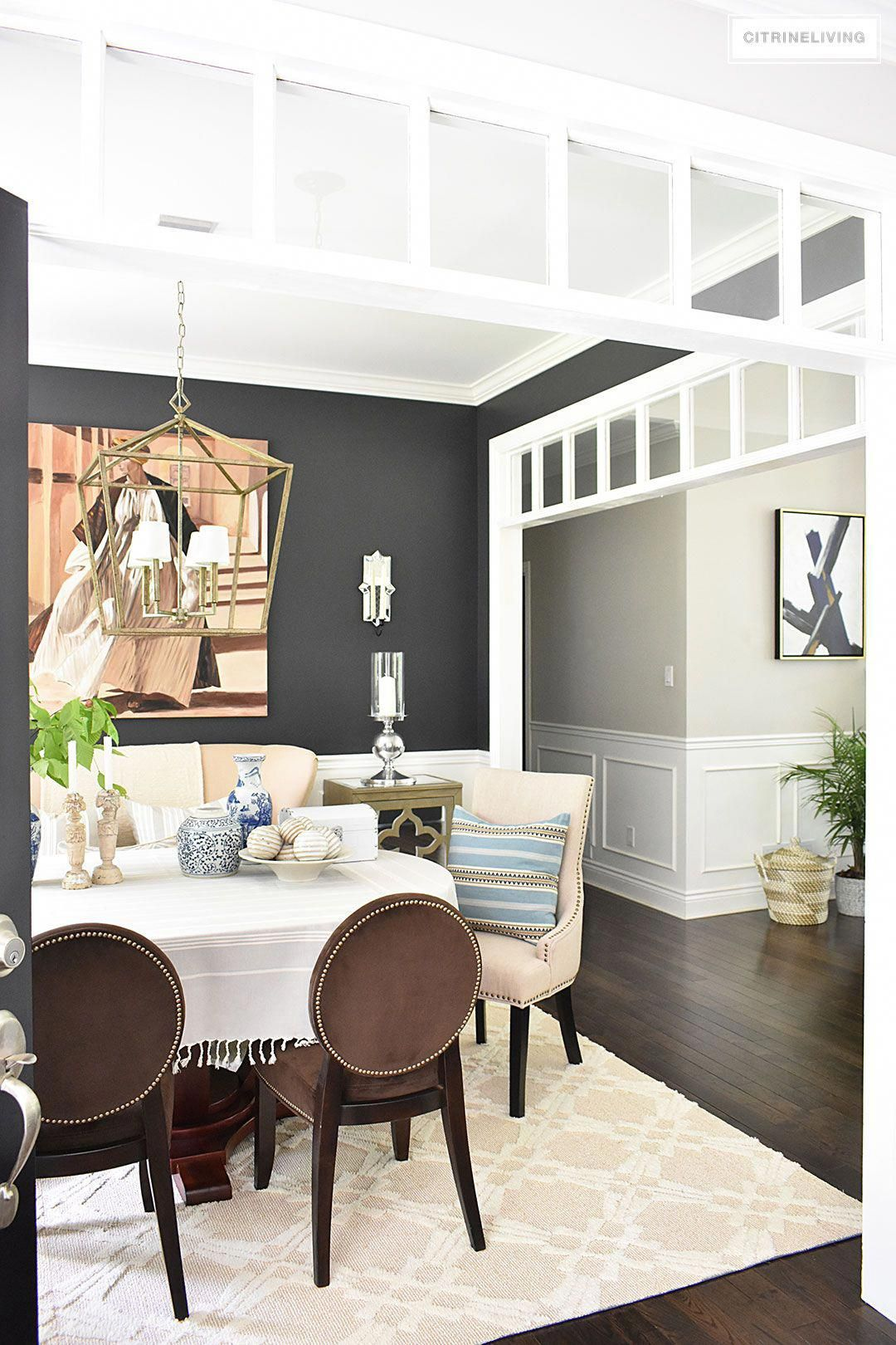 Refined Elegance Black Living Room Set Sophisticated and elegant dining room with transom details. Black walls  painted in Cracked pepper by