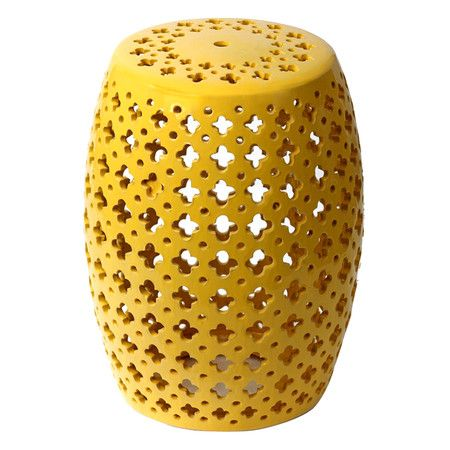 Featuring a yellow finish and quatrefoil cutouts this ceramic