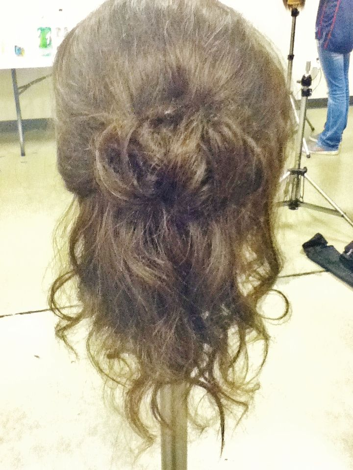 Curls with a half updo.