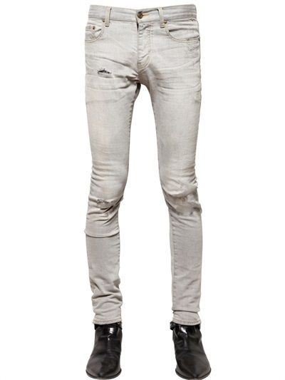 $690, Grey Ripped Skinny Jeans: Saint Laurent 155cm Skinny Ripped Denim Jeans. Sold by LUISAVIAROMA. Click for more info: https://lookastic.com/men/shop_items/148337/redirect