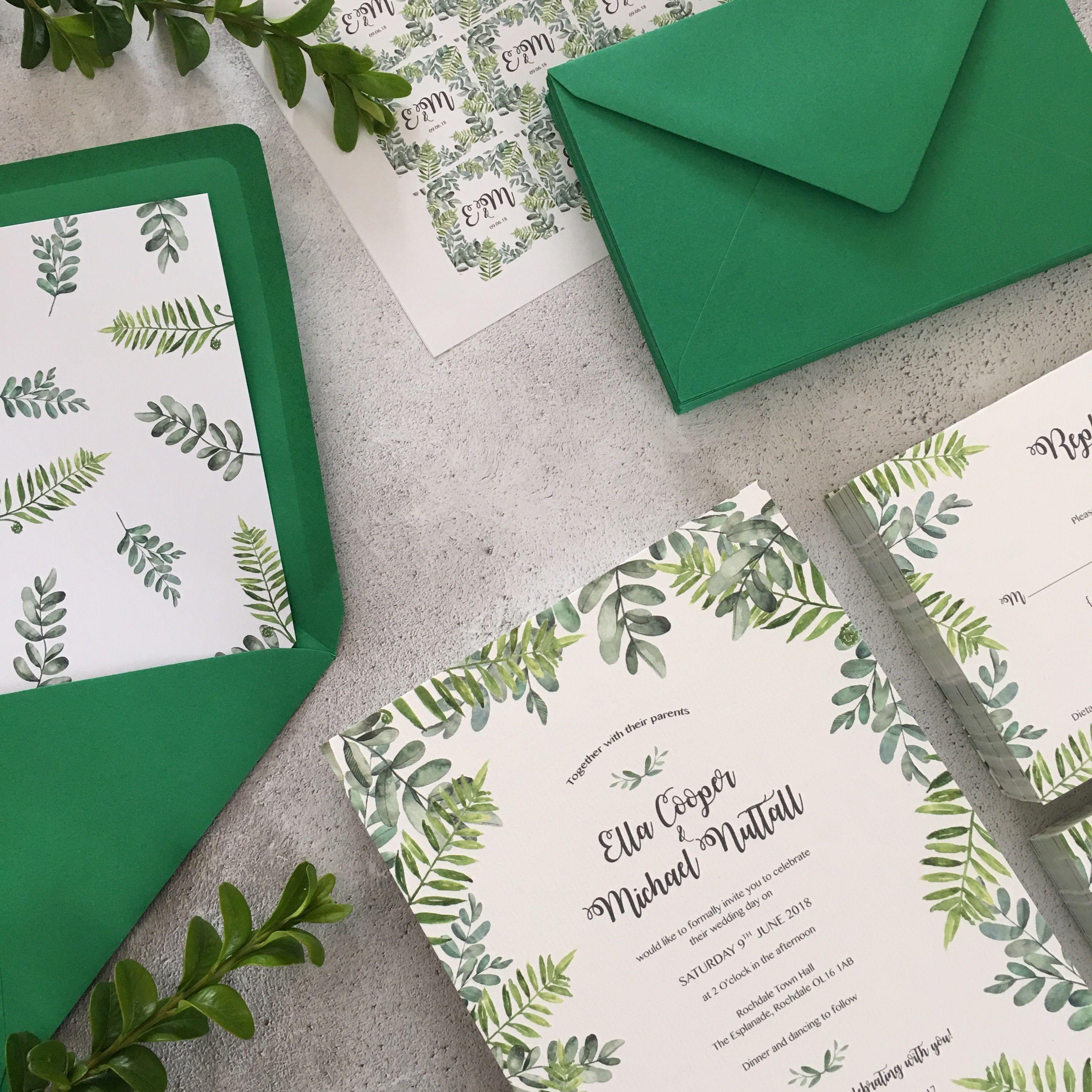 Green botanical wedding invitation design complete with envelopes ...