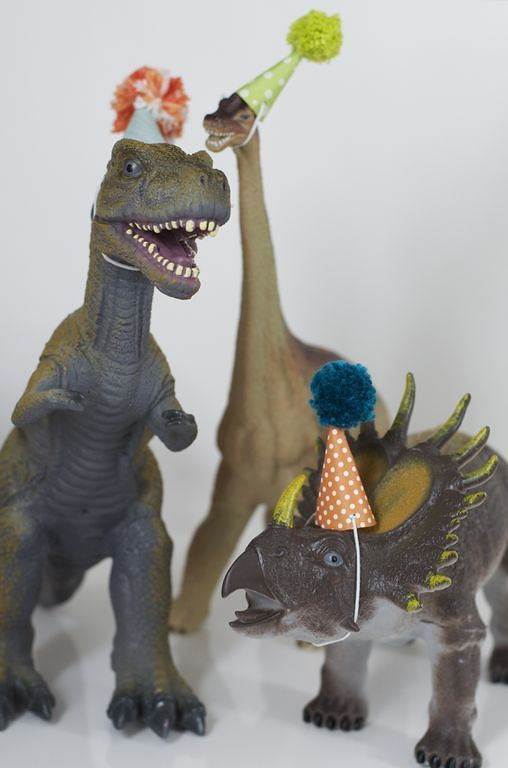 Why not make little party hats use a few dinosaurs as party decor