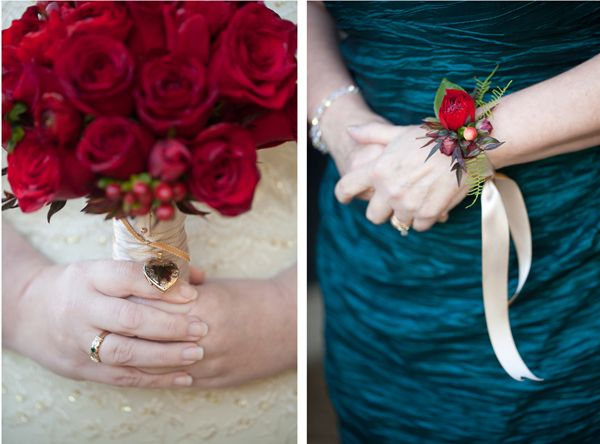 Red rose bouquet with locket and rose wrist corsage with satin ribbon.