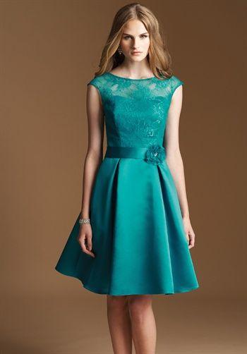 Dress features lace flower accent. Silhouette: A-Line Neckline: Bateau Gown Length: Short Sleeve Length: Short Sleeve Style: Cap Fabric: Satin, Lace Embellishments: Lace