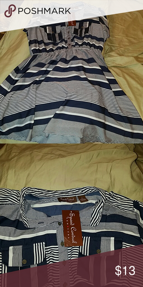 NWT navy shirt dress! Has pockets, pockets on chest, buttons to waist and rolled sleeves with buttons and tabs.  Is a juniors 2x, so fits like a 1x! Speed Control Dresses