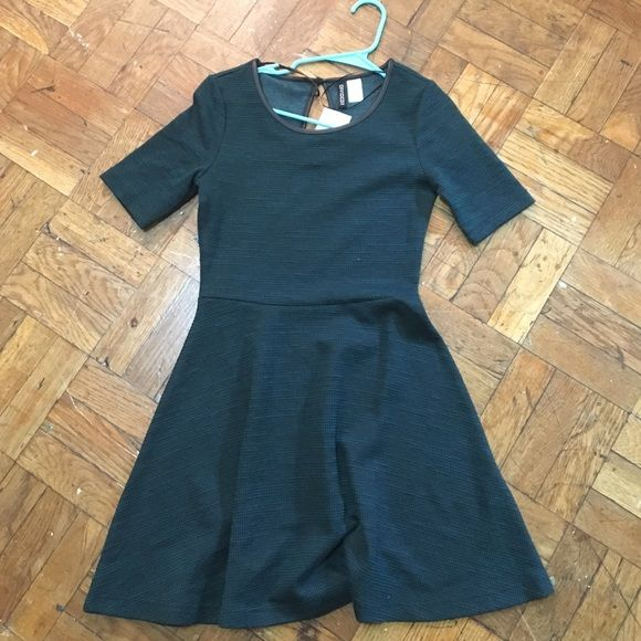 Dark green skater dress Quite a thick material and a nice nearly 3/4 length sleeve H&M Dresses Mini