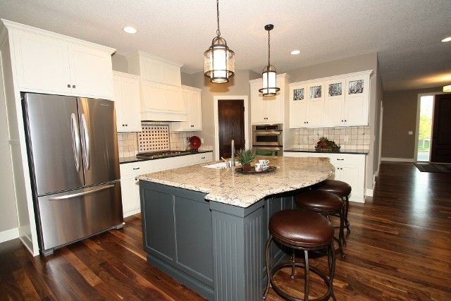 LDK kitchen with clean white enameled cabinets and hood ...