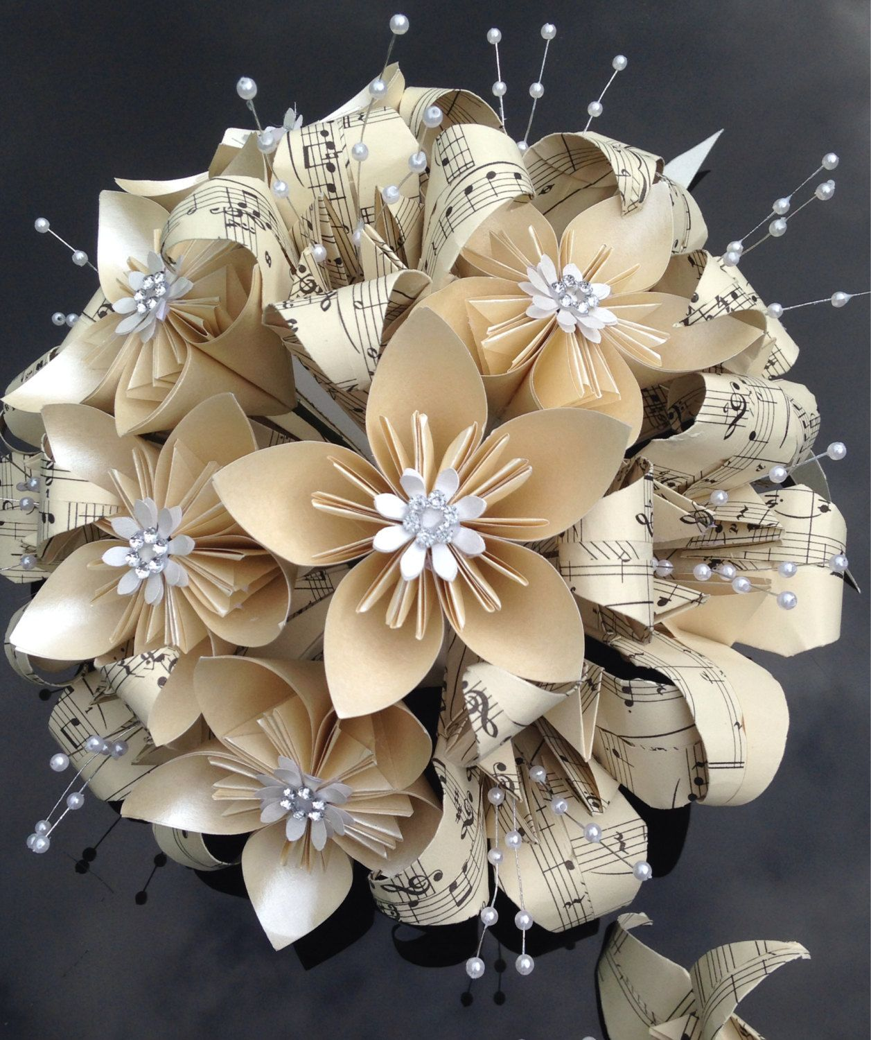 Vintage music paper wedding bouquet and groom's by