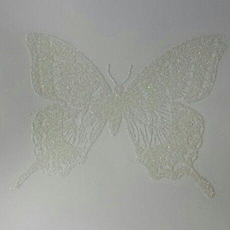 Swallowtail stamp, embossing buddy static remover, versamark ink, heat&stick powder, embossing gun, dazzling diamonds glitter, and one more round with the heat gun