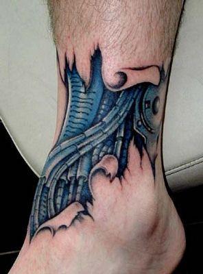 tatouage biomécanique jambe  A voir sur http//www.phototattoo.fr