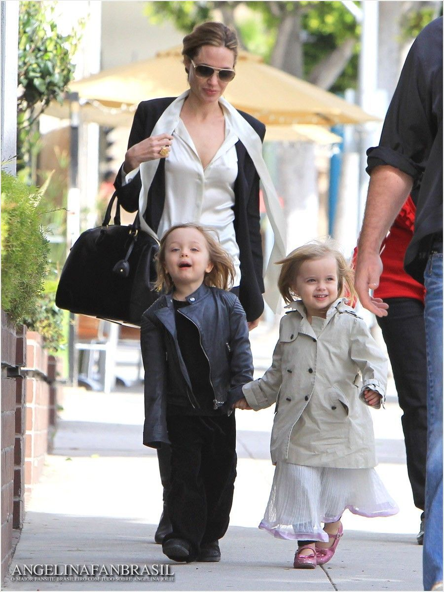 Angelina Jolie and children. I believe these are the twins. How adorable. The blonde in the pic.