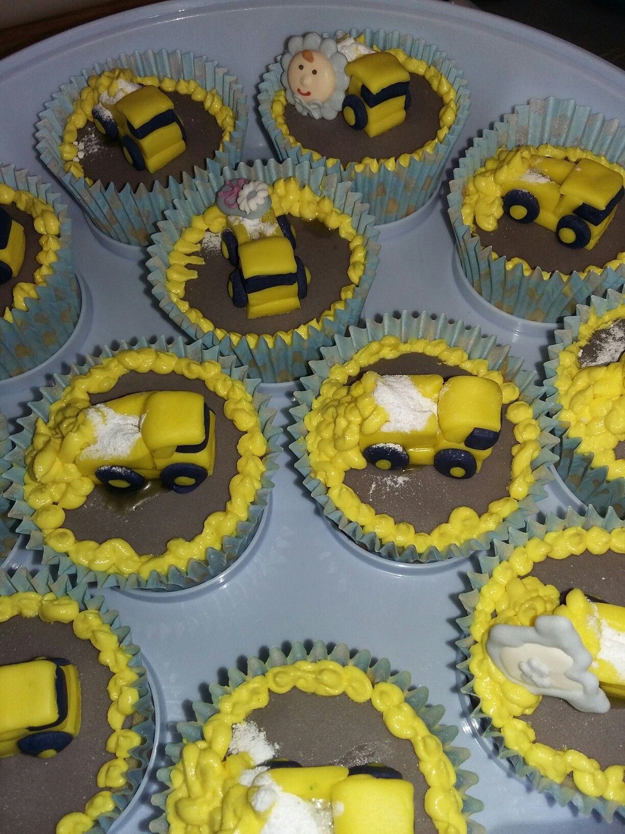 Baby shower cupcakes with a yellow digger theme for baby boy. tplh