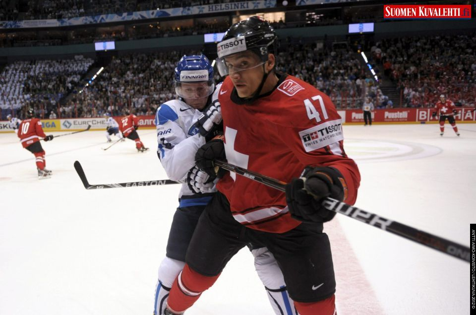 Finland S Petri Kontiola B Tackles Luca Sbisa Of Switzerland