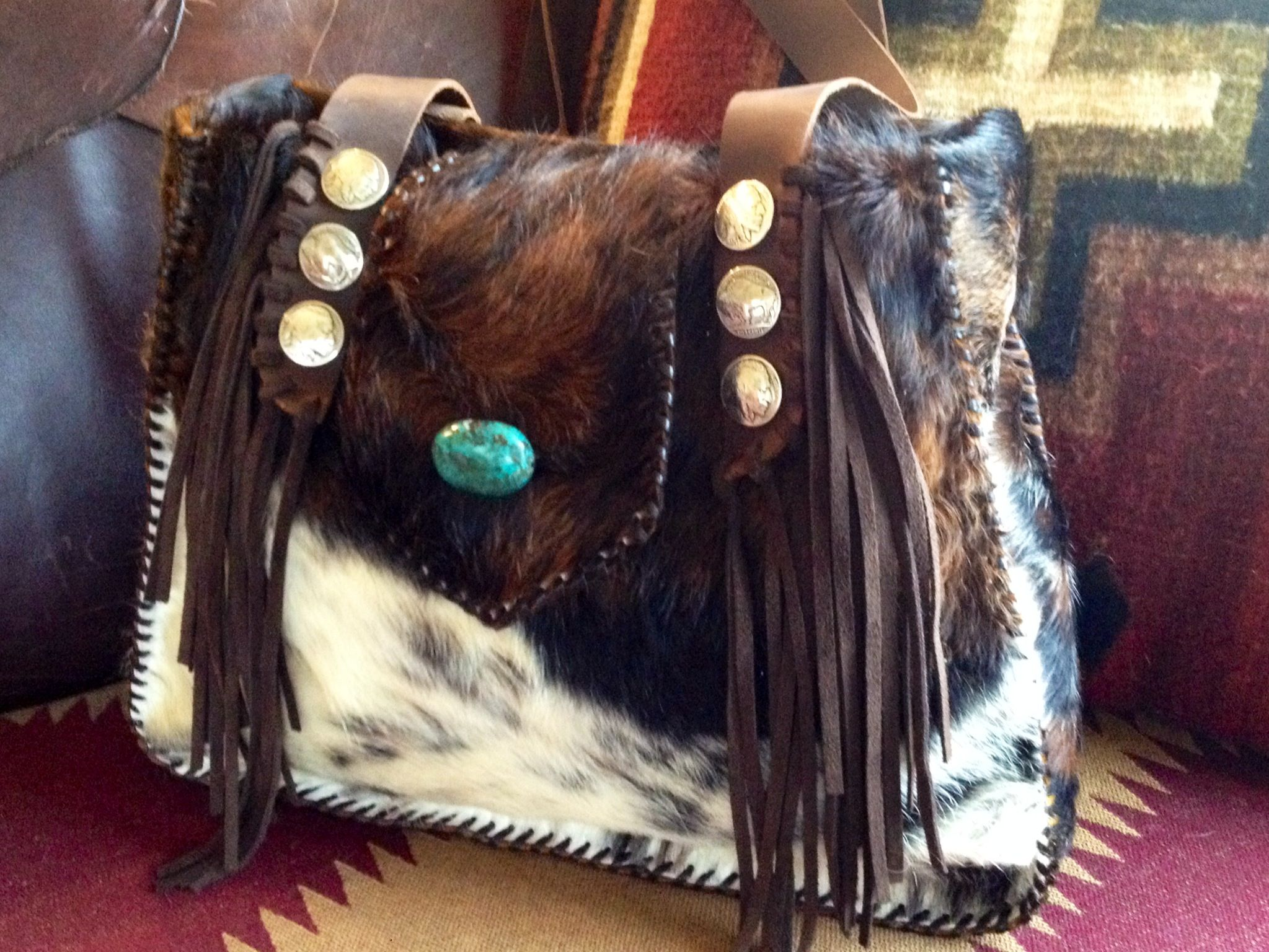 Little Big Bonnie from Go West Designs. Buffalo nickel conchos, turquoise, cowhide and suede. Made to order at gowestdesigns.us.