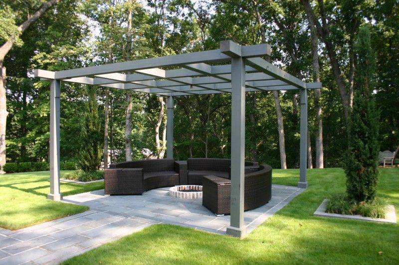 Contemporary Patio Idea With Solid And Dark Grey Pergola Concrete Pavers Walkway Rounded Couch In Black Center Firepit O Outdoor Pergola Modern Pergola Pergola