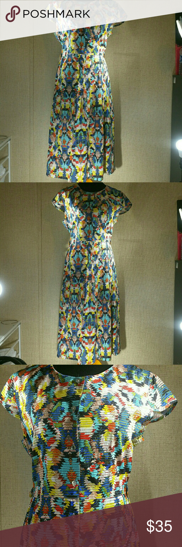 "Multi Colored Empire Waist Party Dress This dress has no tags in it so I'm not sure of size. Be sure look at the measurements to be sure the dress will fit. I wear as size 14 and it fit me   This dress is beautiful. It has an empire waist with multi colors. Even though this dress is vintage the print and style of dress is very current.  Length 43"" Armpit to Armpit 20 Vintage Dresses"
