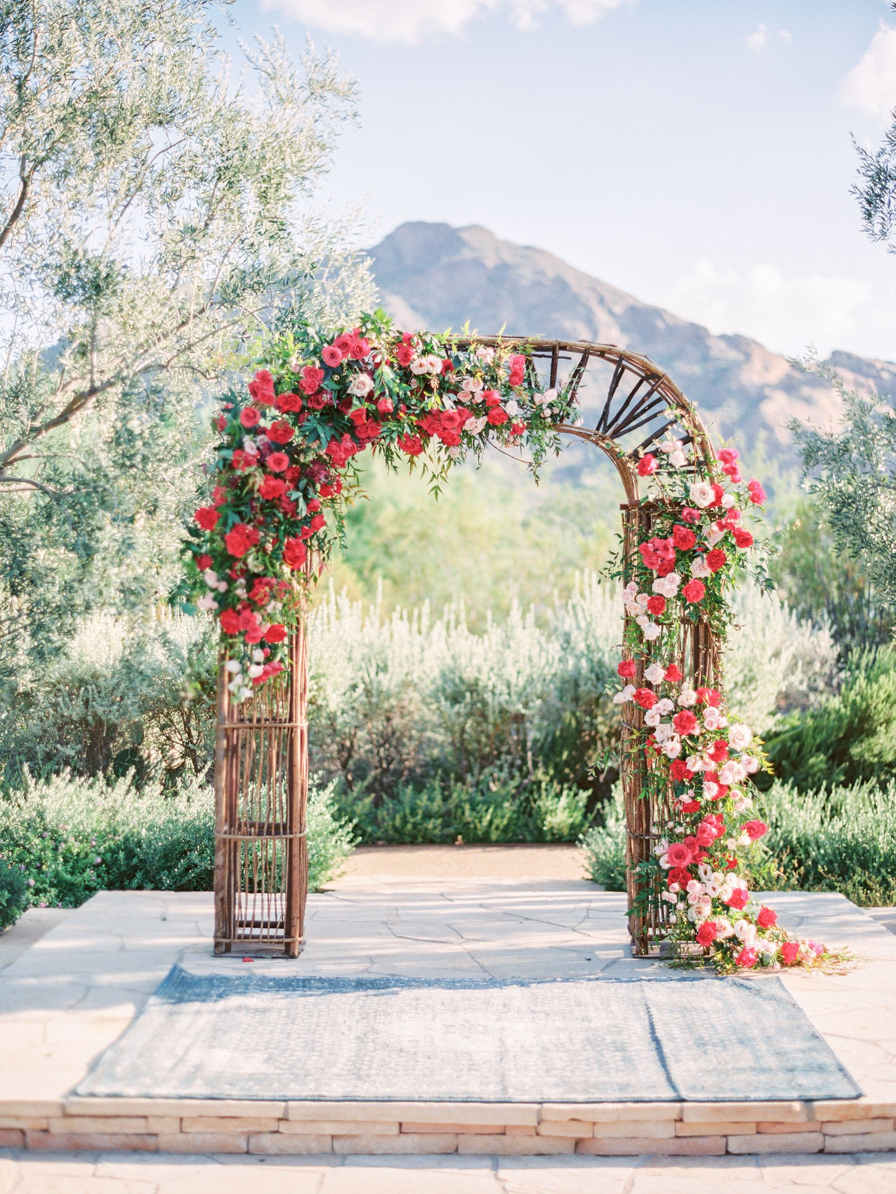 Our Enchanted Garden Arch With Decadent Red And Pink Roses Makes