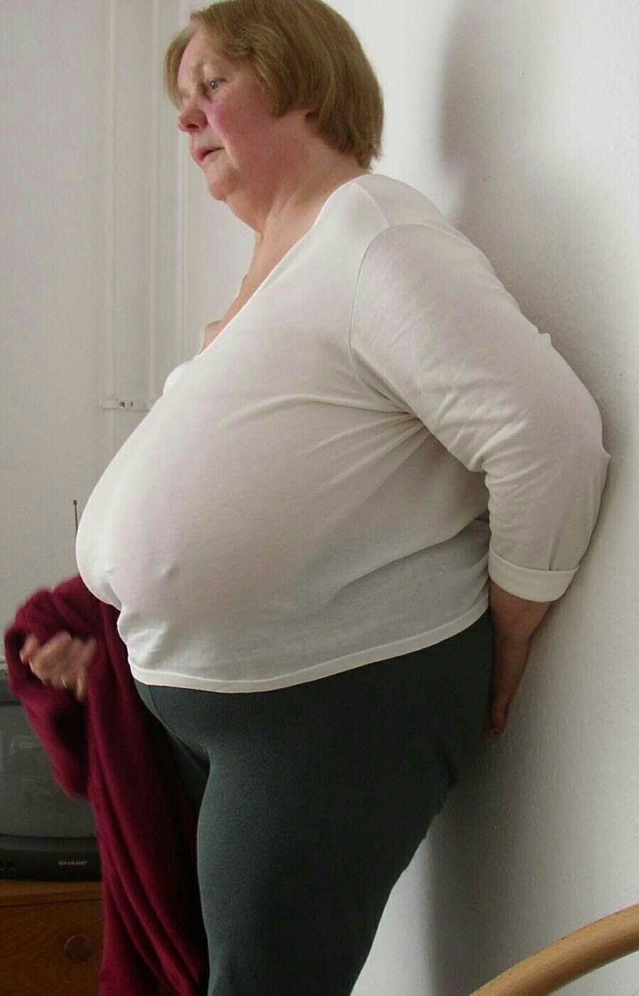 Old Lady With Large Breasts