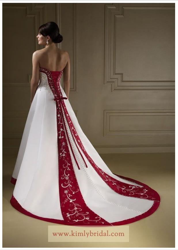 vestido de novia con detalles rojos, tipo princesa. | vestidos