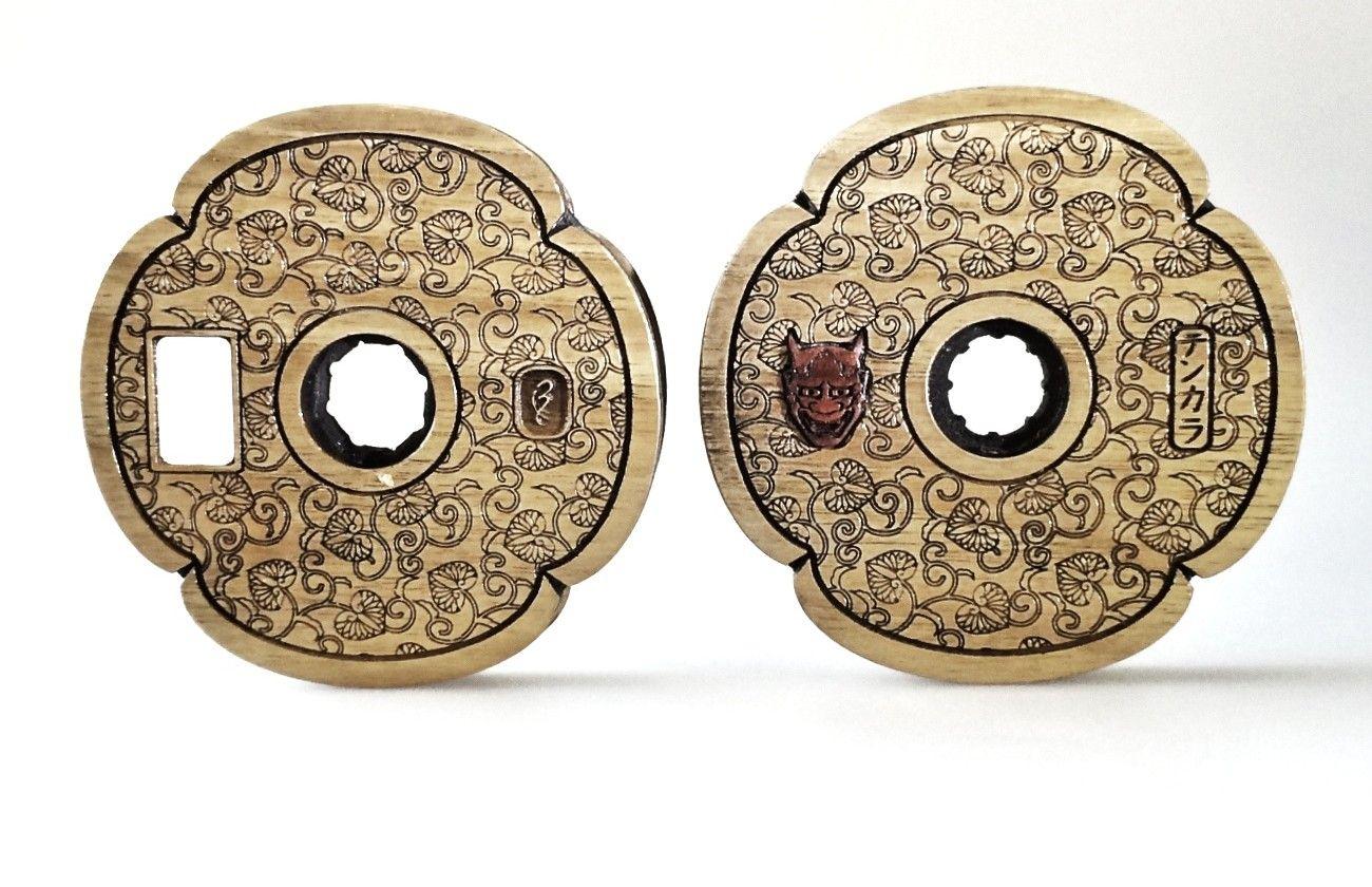 Wooden tenkara line spool with demon mask: http://www.thetenkarashop.com/product/oni-wooden-spool/