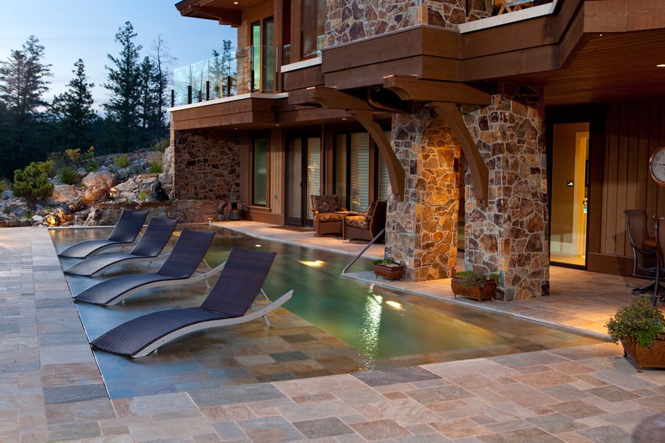 Beautiful lap pool with tanning shelf.  By Valley Pool and Spa