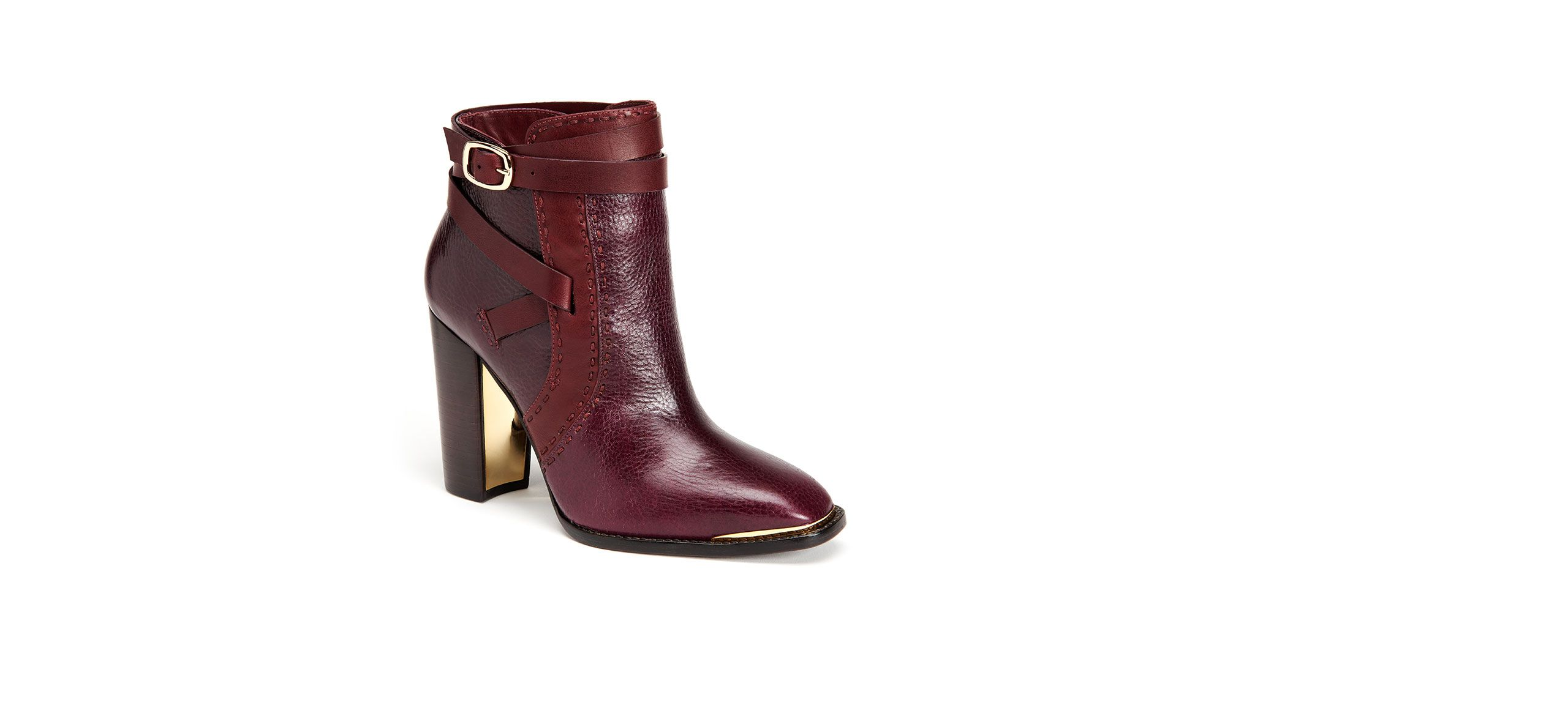 From their tumbled vachetta design to a wooden base and wraparound buckle detailing, these ankle boots are simply stunning.
